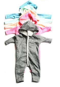 This ultra-cozy hooded one piece is the perfect lightweight layer that will be perfect from chilly Summer nights to cool Fall days. Made from our soft cotton blend fabric, finished with a stylish 3/4