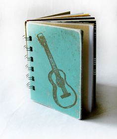 How cute is this?  I think I need to get myself a bind-it-all.