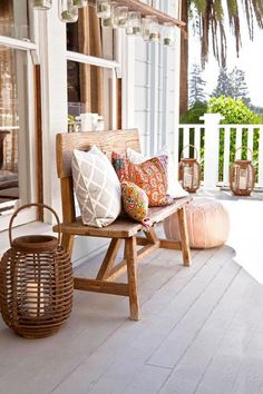 A pile of pillows softens any seat. Candles in lanterns warm the look. Midwest Living
