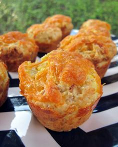 BACON & EGG BREAKFAST MUFFINS 4 eggs, scrambled 1/2 pound bacon, cooked until crisp 2 cups flour 1 Tbsp baking powder 1 tsp salt 1/2 tsp dry mustard 1/2 tsp ground black pepper 1 cup cheddar cheese, grated, divided 3/4 cup milk 1/4 cup oil 1 raw egg