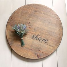 Around the table, with our loved ones, we share with one another. This wooden lazy susan is perfect reminder to sit on your counter and serve your family or guests. By Face to Face Designs.