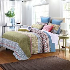 The Shangri-La quilt set fills your space with tranquility. This serene set offers a quilt and two shams in soft colors, crafted of 100-percent cotton.