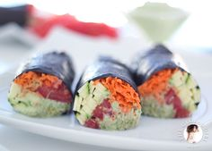 Raw vegan nori rolls with creamy cilantro sauce, shredded carrots, zucchini, tomatoes and clover sprouts. 100% gluten free, dairy free and o...