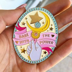 Babe with the Power    One of my most popular designs from the magical girl collection is now available in this beautiful, large gold enamel pin!    ♥ 2.5 inches tall  ♥ Made from high quality, gold plated soft enamel!  ♥ Backed with two clutches for extra safety.