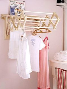 mount an accordion-style drying rack on the wall to air-dry delicate items. When it's not in use, collapse it back against the wall.