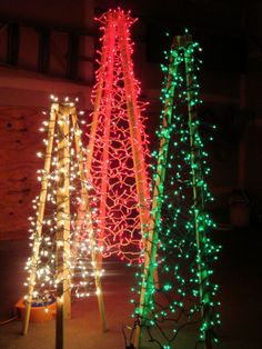 OutdoorChristmasTrees - could build the stands but could find another way to wrap those lights around some wood sticks by digging them into the ground