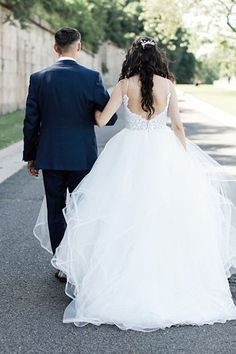 Romantic Wedding photo of bride and groom walking with bride in a ball gown - Bluespark Photography | A Classic Wedding Day Filled with Blush Glam Details