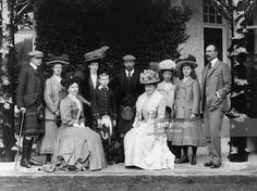1910: In the centre, King George VI, (1895 - 1952), as Prince Albert, his father King George V, (1865 - 1936), his mother Queen Mary, (1897- 1953) and third from right, his sister, Mary, Princess Royal. On the right is Prince Alexander George of Teck, Earl of Athlone, Queen Mary's brother, and seated left, his wife, Princess Alice of Albany, Countess of Athlone. Also in the group, at Mar Lodge, are members of the Fife family.