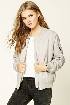 Style Deals - A woven bomber jacket featuring a faux fur lining, front slit pockets, long sleeves, a sleeve zipper pocket, and a ribbed trim.