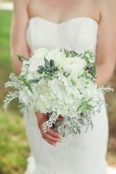 White bouquet with green foliage from Petal Pushers - http://www.stylemepretty.com/texas-weddings/2014/09/22/sweet-texas-wedding-at-vista-west-ranch/   Photography: SMS Photography - http://www.smsphotographyblog.com/
