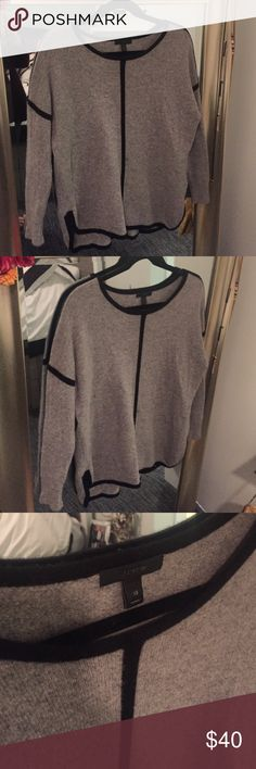 J. Crew Black Lined Sweater Great condition! No pilling. Labeled Xs, but could definitely fit larger sizes too! Flowy and roomy, could definitely pair a light turtle neck Tee under it! J. Crew Sweaters