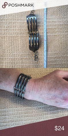 Handmade Bent Silver Fork Bracelet This is a cool bracelet, it was a gift to me. Handmade in Los Angeles. You could polish it up to make it shiny; personally, I love the tarnished look. Jewelry Bracelets