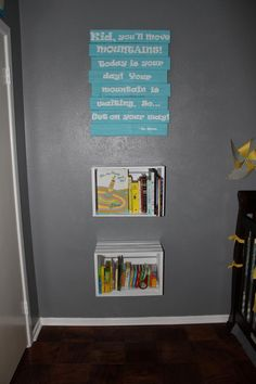 Easton's room!  The Dr. Seuss sign and the crate bookshelves. Blue, gray, and yellow nursery.