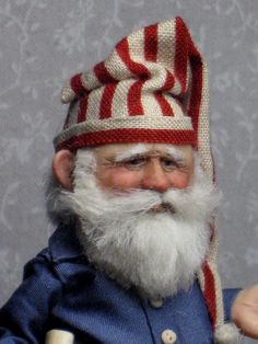 An elfin-like Santa by Sharon Cariola - A great face! Father Christmas, Christmas Elf, Vintage Christmas, Xmas, Santa Doll, Elf Doll, Primitive Santa, Dragons, Santa Claus Is Coming To Town