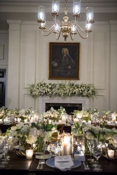 ann whittington events elegant rehearsal dinner southern style country club white flowers greenery mantle artwork country club