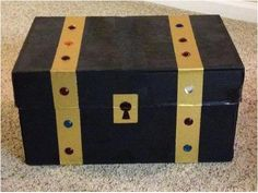 Shoe Box Crafts for Kids Shoe Box Crafts for Kids Treasure Chest. It's really a copy paper box that's painted black with gold duct tape and craft jewels. The post Shoe Box Crafts for Kids appeared first on Craft for Boys. Valentine Boxes For School, Valentines For Boys, Homemade Valentines, Valentine Crafts, Boys Valentine Box Ideas, Treasure Chest Craft, Treasure Boxes, Pirate Treasure, Decoration Pirate