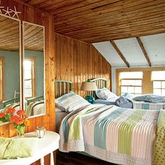 Typical Cottage Bedroom: Wood-planked floors and cozy quilts made of light, sea-colored pastels honor the rustic feel of the century-old cottage, embracing the charm of the setting and the house. Beach Cottage Style, Beach Cottage Decor, Coastal Cottage, Coastal Decor, Coastal Living, Coastal Style, Lake Cottage, Cottage Ideas, Seaside Decor