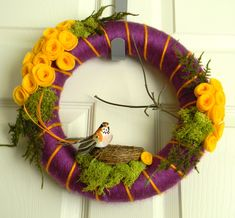 Felt and Yarn Wreath: 12inch Violet and Yellow with Feather Bird  and FREE Micro Wreath. $35.00, via Etsy.