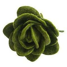 Wool-felted flowers site has much about wool felting