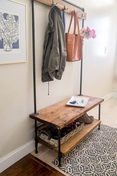 DIY Entryway organizer. She built this organizer from wood and pipe. It's a knock off of the more expensive West Elm version. I like this one even better + it's $300 less.