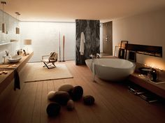 Contemporary bathroom interior design, lovely bathtub, stylish wash basin, wooden flooring, lamp light and carpet  http://www.urbanhomez.com/  http://www.urbanhomez.com/construction/wash_basin_and_toilet_seats  Find Top Interior Designers for an awesome looking Home at http://www.urbanhomez.com/construction/interior_designer Find Top Architects for your Home at http://www.urbanhomez.com/construction/architects http://www.urbanhomez.com/suppliers/architects/mumbai