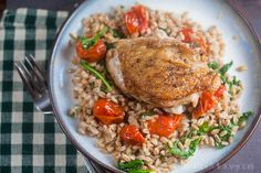 Nutty farro and crispy chicken thighs pair perfectly with sweet + spicy burst tomatoes. So good, the tomato-hater in your house might even ask for seconds!