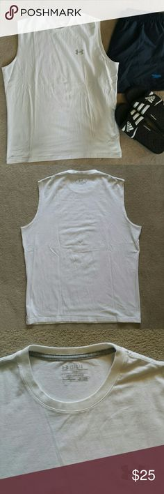 Men's Under Armour Sleeveless Shirt Under Armour loose fit white sleeveless shirt.  Heat Gear.  95% cotton,  5% Elastane. Very soft.  Like new condition. rips, stains, or imperfections. Smoke free house.   Navy speedo shorts are also available. I offer bundle discounts. Under Armour Shirts Tank Tops
