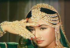 Meena Kumari in Paleezah wearing amazing jewellery . http://www.lisaeldridge.com/video/25895/100-years-of-bollywood-modern-day-devdas-inspired-makeup-look/ #Makeup #Beauty #Bollywood