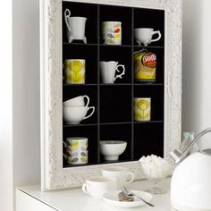 Cool display for tea and coffee cups. I could do this with my pottery mugs...