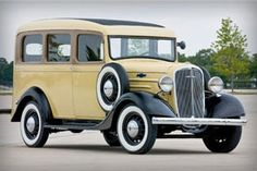 """1936 Chevrolet Suburban  The early Suburban was the grandfather of the modern SUV. However, the steel-bodied, truck-based Chevy Suburban """"Carryall"""" originated as a more robust and accommodating alternative to """"woodie"""" station wagons when it was introduced in mid-1935."""