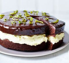Chocolate & lime cake Give chocolate cake a zesty lift with lime buttercream filling, chocolate and lime icing and candied zest to decorate – an irresistible flavour pairing! Citrus Cake, Lime Cake, Bbc Good Food Recipes, Baking Recipes, Cake Recipes, Buttercream Filling, Chocolate Coating, Cake Tins, No Bake Cake