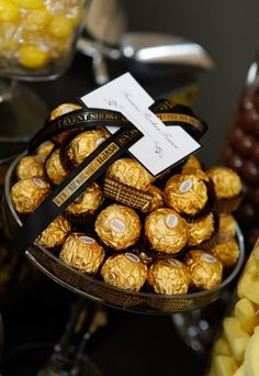Egyptian Party : Candy & decor : Gold wrapped chocolates in a jar as treats for a candy bar or after dinner sweets