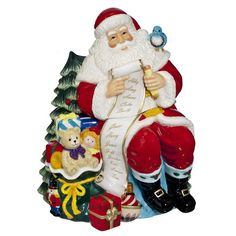 Marquis by Waterford hand painted ceramic Santa cookie jar. This adorable Santa cookie jar is the perfect gift or added decor to any home. The removable lid allows plenty of storage for cookies and candy. Gift boxed.