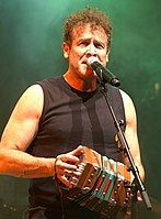 7 June, 1953 ~ Johnny Clegg, South African musician and anthropologist who has recorded and performed with his bands Juluka and Savuka, and more recently as a solo act, occasionally reuniting with his earlier band partners. Steve Winwood, Nelson Mandela, George Michael, University Of The Witwatersrand, George Of The Jungle, Third Culture Kid, Oscar Winning Films, Guinness World, Him Band