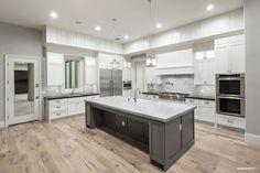 Dream Kitchen, White Cabinets, Grey Island, Marble tops, light grey washed wood floors.