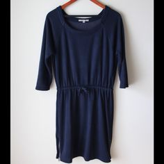 """GAP sweatshirt dress Navy blue sweatshirt dress - super soft - three quarter sleeves - drawstring at waist - zippers at hemline - not lined - rayon/cotton/polyester combo - chest across measures 18.5"""" - total length measures 36"""" - tag says size S but fits size M better GAP Dresses"""