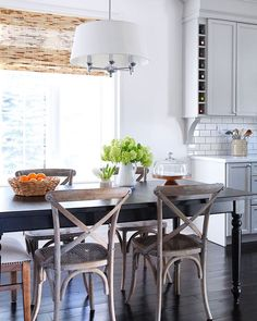 The kitchen table isn't found in every home so they can be a special thing that reminds me of childhood dinners... and getting in trouble at the Sunday dinner table! 😬 This pretty spot is in the kitchen of @chris_kauffman, furniture maker, home renovator, and diy'er extraordinaire. I wonder what kind of trouble we could get into here? #kitchen #kitchendesign #kitchentable #interior #interiordesign #flowers #dining #diningroom #diningchairs #farmhouse #farmhousestyle #restorationhardware…