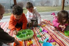 Lay a plastic table cloth on the deck and let them get dirty with playdoh, paint, etc.