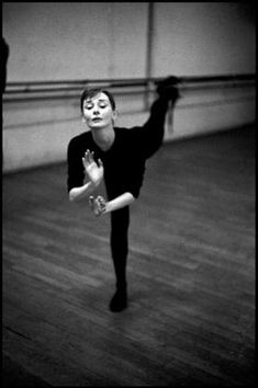 """David Seymour  FRANCE. 1956. Paris. Audrey HEPBURN during ballet rehearsal for the film """"Funny Face."""""""