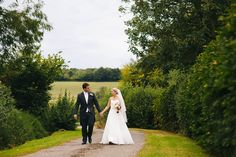 bride and groom on country lane