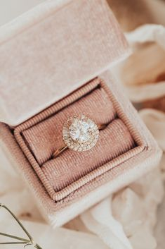 """Known for her courageous involvement in politics while bringing fashion and elegance to the White House, First Lady Florence Harding was often referred to, by her husband, President Warren Harding, as """"The Duchess."""" With its refined sophistication and eloquent glamour, our Florence ring was designed for a woman of the modern era with a round center 1 ct stone and .33 ct diamond setting with half tapered baguettes and half double round halo. The votes are in. This beauty is majestic!"""