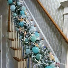 A Coastal Christmas.really full swag for banister in aqua silver white tone. Coastal Christmas Decor, Nautical Christmas, Blue Christmas, Christmas Holidays, Christmas Wreaths, Christmas Crafts, Holiday Decor, Beach Christmas Trees, Coastal Decor