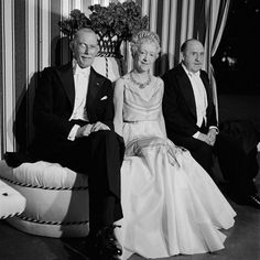 Sir George Clerk, the British ambassador to France; Elsie de Wolfe, in her Mainbocher dress of organza with pastel-tinted plaid stripes; and Sir Charles Mendl on the half-round banquette in the center of the dance pavilion. Elsie De Wolfe, History Magazine, Old Money, High Society, People Around The World, World War Ii, Vintage Fashion, Wedding Dresses, Celebrities