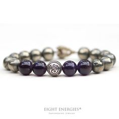 "The ""Golden Path"" helps to:    • Build inner strength  • Restore vitality and energy  • Feel grounded and empowered.  Made With Amethyst and Pyrite Crystal Beads"