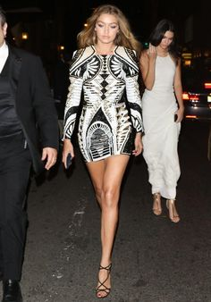 Gigi Hadid wears a Balmain for H&M dress and strappy heels