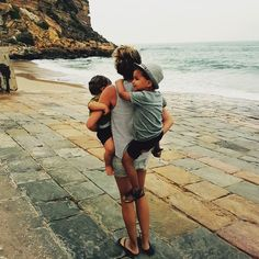 When they both want to be carried by mom. Love you to the moon and back!  Burgau beach, Algarve Portugal. Travel with kids