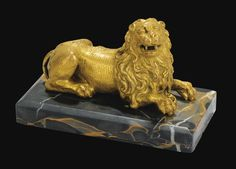 A German, Augsburg, 16th Century Gilt Bronze Reclining Lion; On A Marble Base