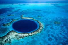Great Blue Hole, Belize       The Great Blue Hole is a huge submarine sinkhole off the coast of Belize that Jacques Cousteau named one of the top scuba diving sites in the world.