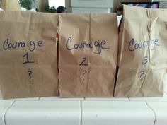 """""""Courageous and strong"""" petal project.  3 volunteers placed their hand inside bag, not knowing what was  in them, to show courage. (I used coffee grinds, chocolate pudding  cake frosting) You can put anything in the bag,  use different textures."""