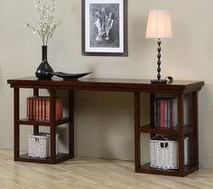 Give yourself more room to decorate with this large console table. The dark color of this table will complement most color schemes and the simple design allows it to fit in with any decor. Display decorative items on the long top and four shelves.